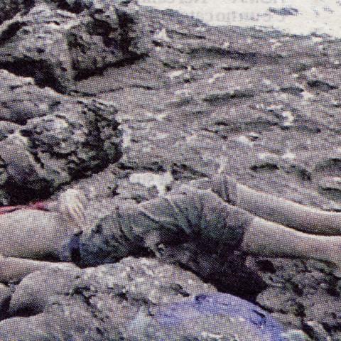 Isola/Esodo/Esilio | Clandestino (Povero Cristo), 2009. Riproduzione su tela, a colori, di una fotografia ritagliata in un giornale (128x170cm).