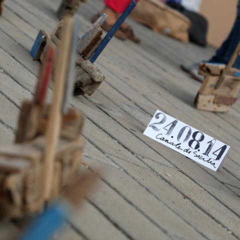 Isola/Esodo/Esilio | Esodo, 2011. Barche costruite con legnetti erosi dal mare. Installazione in situ (Ph. Igor Petyx).